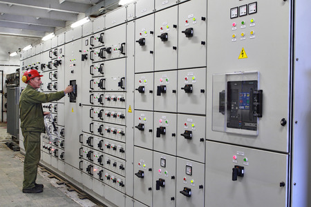 Veliky Novgorod, Russia - June 26, 2007:  Electrical engineer  high voltage switchgears maintenance, chemical Plant.