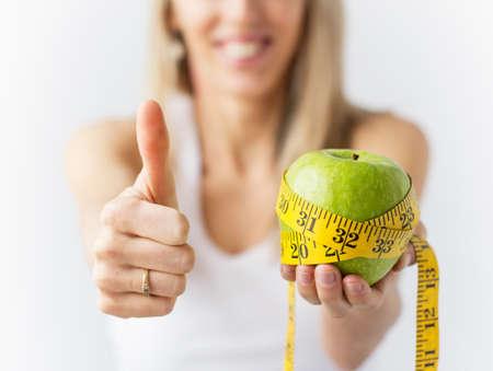 Woman enjoying successful weight loss