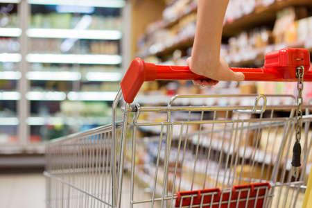 Photo pour Close-up photo of shopping cart in supermarket - image libre de droit