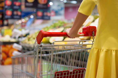 Photo for Woman shopping for groceries in supermarket - Royalty Free Image