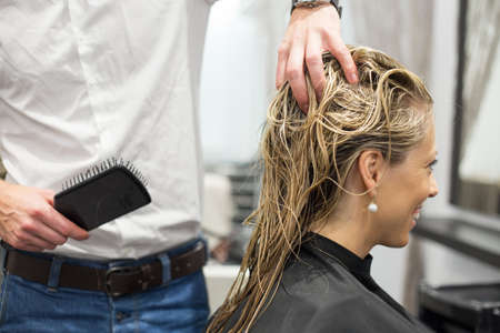 Blonde woman in hair salon