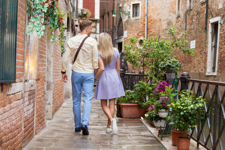 Tourist couple walking in romantic city