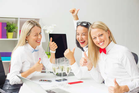 Women colleagues celebrating business success