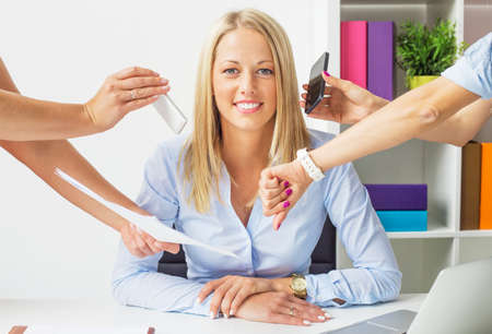 Photo pour Stress free business woman in the office - image libre de droit