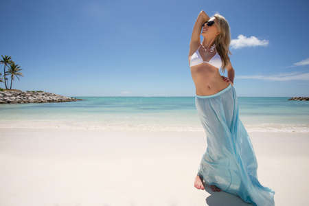 Woman enjoying tropical weather on the beach