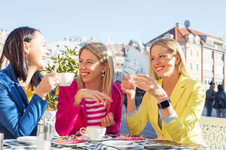 Three women having a fun conversation