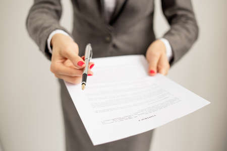 Woman offering to sign papers