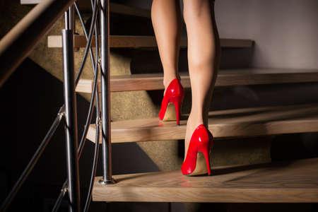 Foto de Woman walking up stairs - Imagen libre de derechos