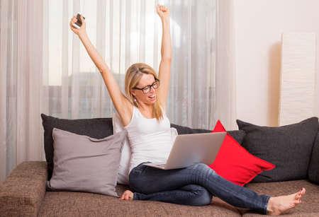 Photo pour Woman celebrating her success with hands up - image libre de droit