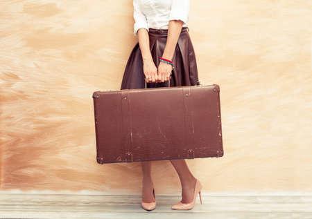 Photo pour Woman holding antique suitcase for traveling - image libre de droit