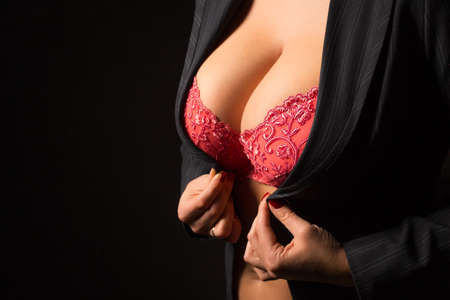 Photo pour Woman with big breasts getting dressed - image libre de droit