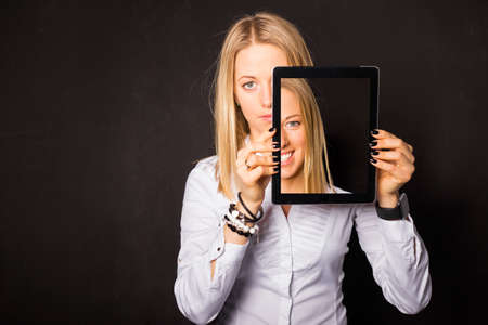 Photo for Woman standing with tablet in her hands - Royalty Free Image