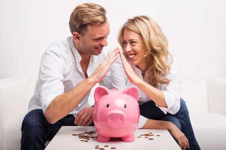 Photo pour Couple saving money to buy house - image libre de droit