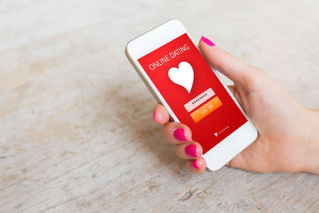 Woman using dating app on smartphone