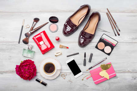 Women's fashion and beauty objects and accessories on wooden floor