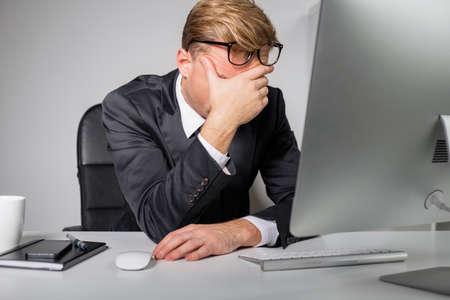 Photo pour Tired man  holding his forehead - image libre de droit