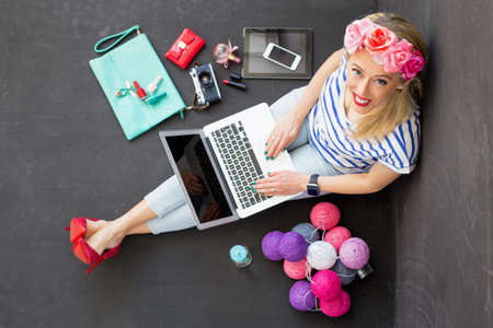 Photo for Fashion blogger with computer looking up - Royalty Free Image