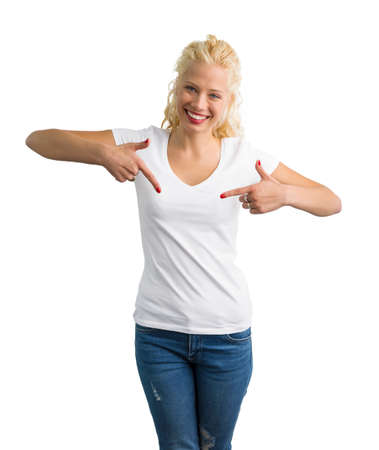Woman in white V-neck T-shirt pointing at it with both hands