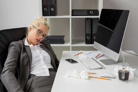 Business woman sleeping in the office
