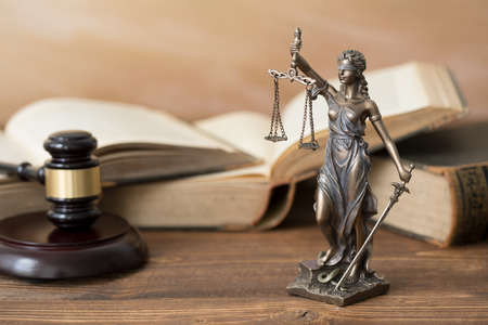 Themis statue,books  and gavel on wooden table