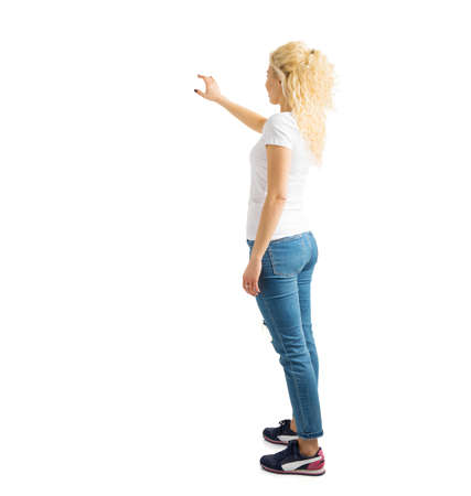 Woman standing and pointing at white background
