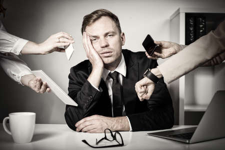 Photo pour Man overwhelmed with tasks and responsibilities at work - image libre de droit