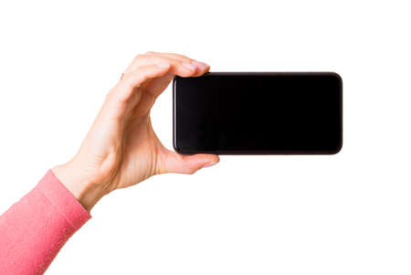 Photo pour Person holding mobile phone horizontally, photo isolated on white background - image libre de droit