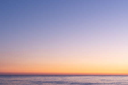 Foto de Colorful sky after sunset. Sunset on the background of the sea. Blue hour. - Imagen libre de derechos