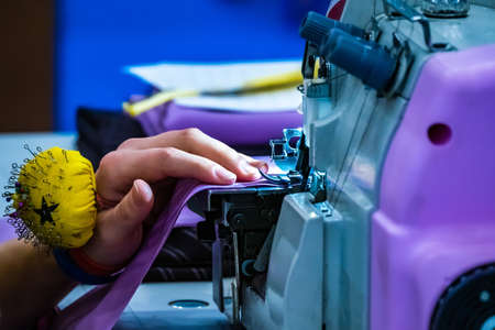 Photo pour Atelier studio. Dressmaker sewing process. Sewing on the sewing machine. Seamstress's workshop. Individual tailoring. Tailoring to order. Tailor working for a sewing machine. - image libre de droit