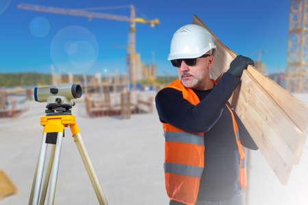 Photo pour Surveyor and carpenter on the construction site. Types of construction work. Construction of buildings. Vacancies for builders. - image libre de droit