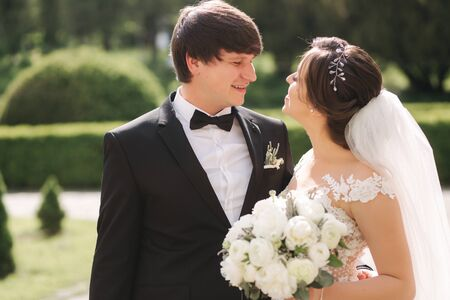 Photo pour Close-up portrait of beautiful wedding couple. Handsome groom with gorgeous bride - image libre de droit