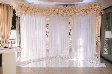 Photo pour Different decor on wedding. Flowers, stools, rings champagne. - image libre de droit