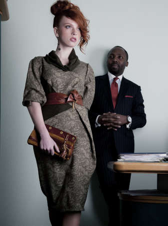 Black american man looking at walking red haired woman