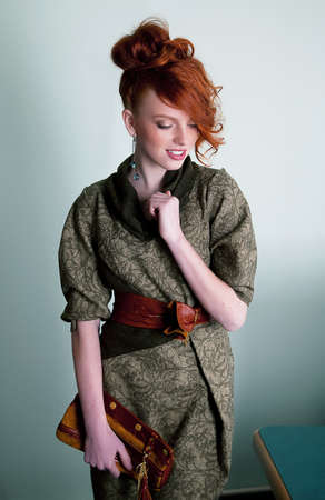 Sensual red head fashion model in dress - series of photos
