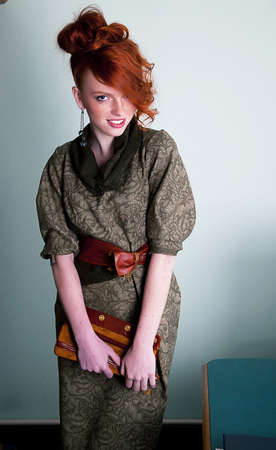 Pretty young redhaired freckled woman fashion model