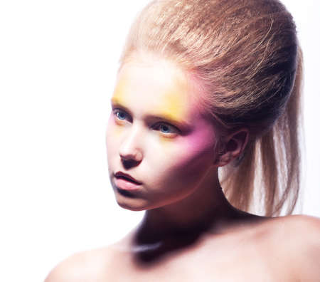 Beautiful blonde woman face with bright colorful make-up