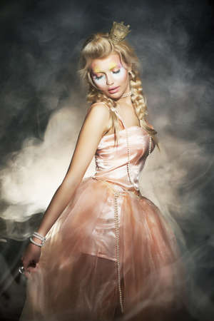 Young blonde woman in classic retro dress. Romantic lady in shadows