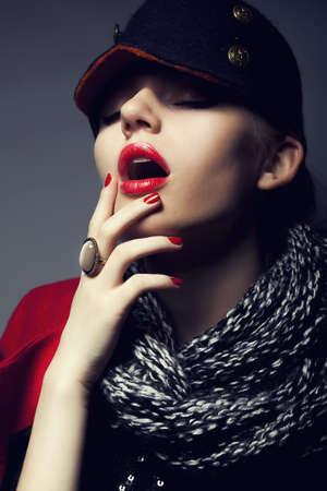 Trendy fashion beautiful female in modern black cap - stylish make-up