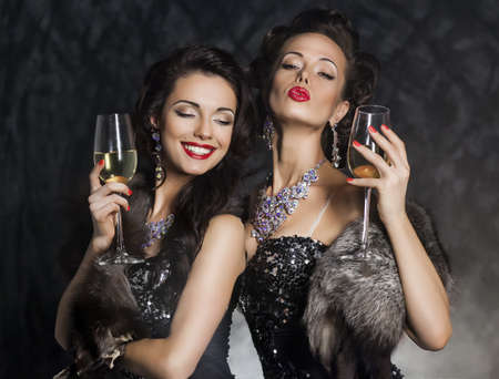 Happy New Year - two women with wine glasses smiling