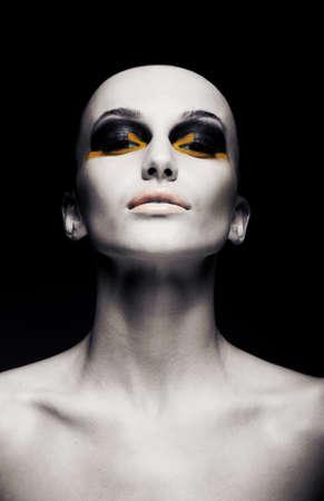 Photo pour Beautiful bald futuristic unusual woman - clean shaven head. Conceptual fashion design - image libre de droit