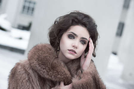 Femininity  Portrait of Sophisticated Young Brunette in Brown Fur Coat Outdoors