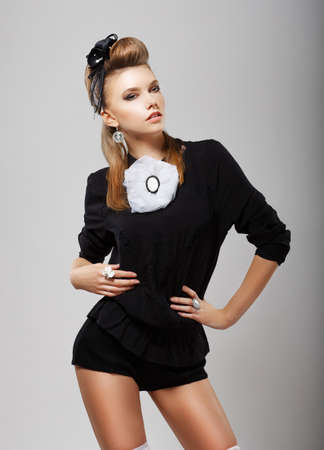 Individuality. Stylish Woman in Black Costume - Shorts and Blouse. Fashion Style