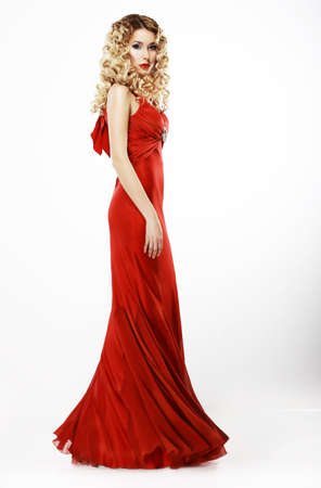 Luxury  Full Length of Elegant Lady in Red Satiny Dress  Frizzy Blond Hair