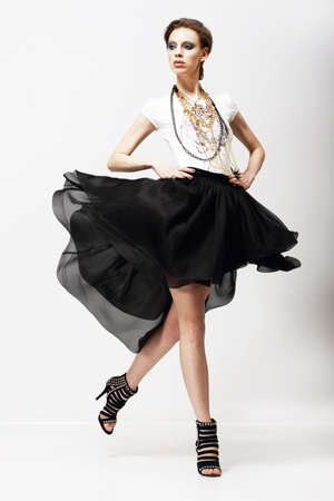 Foto de Motion. Vitality. Luxurious Supermodel in Fluttering Fashion Dress. Oscillation - Imagen libre de derechos