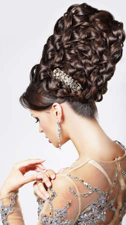 Luxury  Fashion Model with Trendy Updo - Braided Tress  Vogue Style