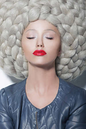 Fantasy  Creativity  Portrait of Trendy Woman in Futuristic Sumptuous Huge Wig with Braids