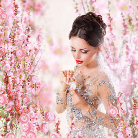 Woman with Perfume over Floral Backgroundの写真素材