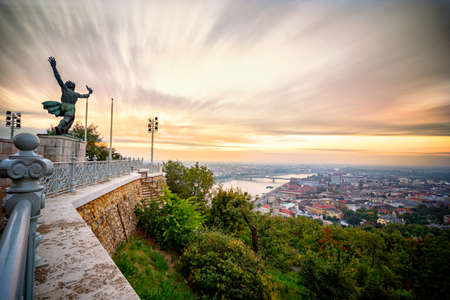 Statue during sunrise facing Danube River in Budapest