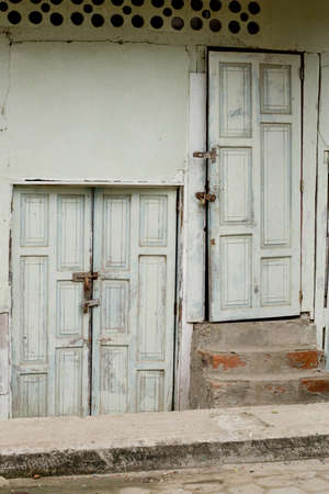 two old doors in weathered wall