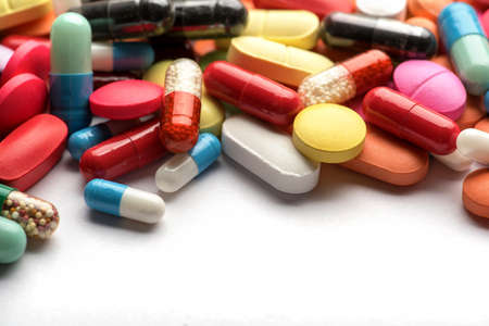 Photo pour Pharmacy theme. Multicolored Isolated Pills and Capsules - image libre de droit